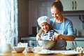 Happy Family In Kitchen. Mother And Child Preparing Dough, Bake Royalty Free Stock Images - 87310849