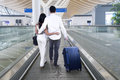 Young Couple Embracing Together On The Escalator Royalty Free Stock Photos - 87315888