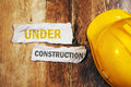 Under Construction Concept With Protective Yellow Hard Hat Helme Royalty Free Stock Images - 87335849