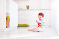 Cute Ginger Baby Boy Playing With Toys In Bright Kitchen, At Home Stock Photography - 87344832