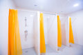 Public Shower Room With Several Showers. Big, Light, Empty Public Shower Room, With Bright Walls And Gray Floor Royalty Free Stock Image - 87386306