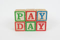 The Word Pay Day In Wooden Childrens Blocks Stock Photos - 87387693