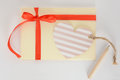 Light Yellow Envelope With A Red Ribbon, Heart Card And Pencil On A White Background Royalty Free Stock Photo - 87389895