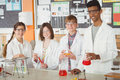 Portrait Of School Kids Doing A Chemical Experiment In Laboratory Royalty Free Stock Photo - 87391545