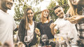 Happy Friends Having Fun Drinking Red Wine Eating At Garden Party Royalty Free Stock Photo - 87448705