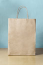 Blank Brown Shopping Bag On Table With Blue Background Stock Image - 87456861