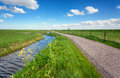 Beautiful Landscape With Green Grass Field, Road, Lighthouse Royalty Free Stock Photo - 87458695
