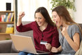 Excited Roommates Buying On Line At Home Stock Photo - 87461470