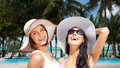 Happy Young Women In Hats On Summer Beach Stock Images - 87469434