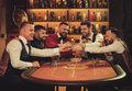 Group Of Upper Class Men Toasting In Gentlemen`s Club Royalty Free Stock Images - 87471589