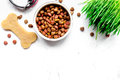 Dry Dog Food In Bowl On Stone Background Top View Stock Photo - 87472470