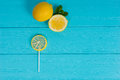 Lollipop As A Lemon On Wooden Turquoise Board Near Lemon And A S Stock Image - 87499211