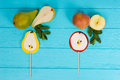 Lollipops As A Pear And An Apple On Wooden Turquoise Board Near Stock Image - 87499231