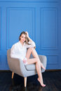 Young Beautiful Girl In White Men's Shirt Sitting In An Armchair Stock Photos - 87499713