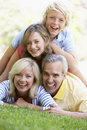 Family Lying On Top Of Each Other In A Park Stock Photo - 8756710