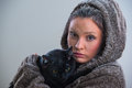Winter Portrait Of Young Kind Woman Holding Big Black Cat Royalty Free Stock Photography - 87500767