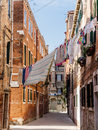 Washing Hanging Between Houses In A Narrow Street Stock Photo - 87509850
