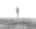 Man Walking In Mist On Dirty Concrete Floor Stock Image - 87511001