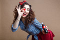 Happy Beautiful Pin Up Girl Holding Cup Of Glass Bottle And Giving You A Soda. Woman Dressed In Red Shirt And Blue Plaid Stock Photography - 87516452