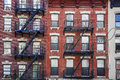 Manhattan, Old Building With Fire Escapes Royalty Free Stock Image - 87525776