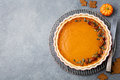 Tasty Pumpkin Pie, Tart Made For Thanksgiving Day In A Baking Dish. Grey Stone Background. Top View Royalty Free Stock Photography - 87538517