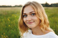 A Portrait Of Beautiful Young Blue-eyed Girl With Light Hair Having Charming Smile And Dimple On Her Face Looking Into Camera Stan Stock Photography - 87547022