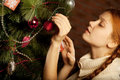 Girl Decorate The Christmas Tree Royalty Free Stock Image - 87619686
