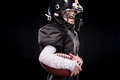 Side View Of Little Boy American Football Player In Uniform Holding Ball Stock Images - 87659474