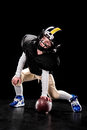 Boy In Uniform And Helmet Playing American Football And Looking Up Stock Photos - 87659743