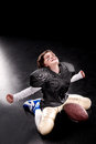 Cheerful Boy American Football Player Sitting With Ball And Triumphing Stock Images - 87659774
