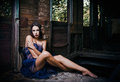 Beautiful Young Woman Covered In Cloth Sits In Abandoned Train Wagon Royalty Free Stock Photo - 87684245
