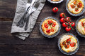 Fresh Homemade Tarts With Cherry Tomatoes And Goat Cheese Royalty Free Stock Images - 87689819