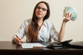Female Bookkeeper Holding Dollars Fan In Her Hand Royalty Free Stock Photo - 87700905