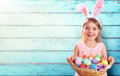 Easter - Little Girl With Basket Eggs And Bunny Ears Royalty Free Stock Image - 87712916