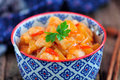Chicken Breast In Sweet And Sour Sauce With Pineapple Slices With Boiled Rice. Rustic Style. Royalty Free Stock Image - 87715276