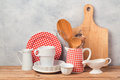 Kitchen Utensils And Tableware On Wooden Table Over Rustic Grey Background Royalty Free Stock Images - 87718869