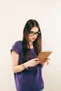 Student Girl Attentively Reading Book, Free Space. Portrait Of Young Woman In Glasses Carefully Studing Material In Stock Photo - 87739710