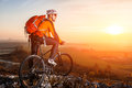 Cyclist With Mountain Bike On Top Observing The View. At Sunset With Lens Flare Royalty Free Stock Photography - 87741947