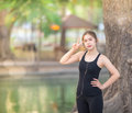 Portrait Of Beautiful Young Woman Exercising Two Fingers Stock Photos - 87765603