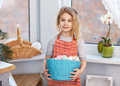 Little Blonde Girl Holding Basket With Painted Eggs. Easter Day. Stock Photos - 87785613
