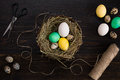 Easter Eggs In Nest, Scissors And Thread On A Black Background Royalty Free Stock Photography - 87795067