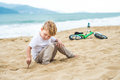Active Blond Kid Boy And Bicycle Near The Sea. Toddler Child Dreaming And Having Fun On Warm Summer Day. Outdoors Games For Childr Royalty Free Stock Image - 87798406
