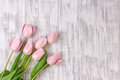 Fresh Pink Tulip Flowers Bouquet On White Wooden Rustic Table Stock Photo - 87806170