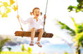 Happy Child Girl Swinging On Swing At Beach  In Summer Stock Image - 87811661