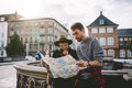Young Tourist Couple Exploring A City Map. Royalty Free Stock Image - 87812666