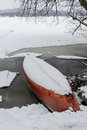 Snow Covered Canoe By Lake. Royalty Free Stock Photos - 87834168
