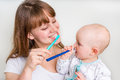 Mother And Her Baby Brushing Teeth Together Royalty Free Stock Image - 87840276