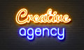 Creative Agency Neon Sign On Brick Wall Background. Stock Image - 87865851
