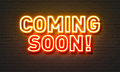 Coming Soon Neon Sign On Brick Wall Background. Royalty Free Stock Photo - 87865865