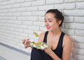 Fit Healthy Woman In Sportswear Eating A Fresh Salad After Fitness Workout. Stock Photography - 87872562
